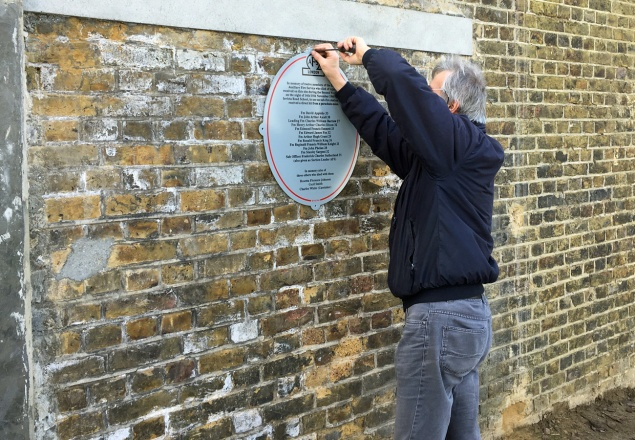 The plaque is erected in the playground