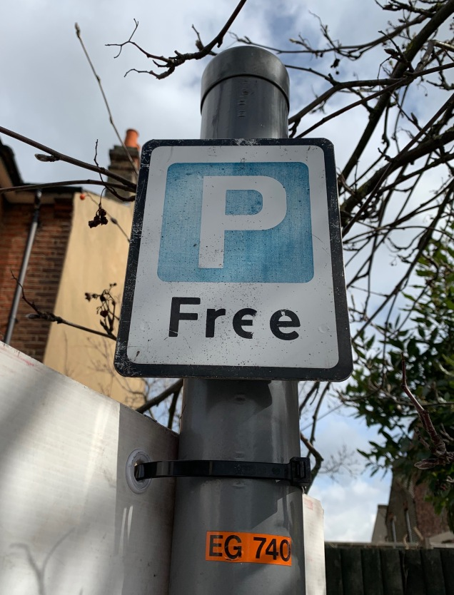 Charlton free parking sign